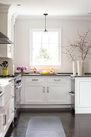 white and gray kitchen with stacked dishwasher drawers