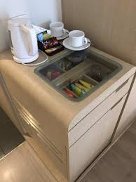 coffee table with mini fridge picture