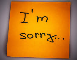 sorry message on sticky note