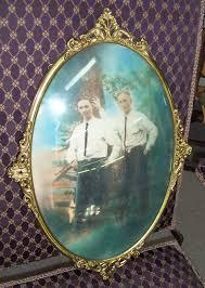 antique metal oval framed photo