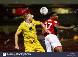 CREWE, ENGLAND - NOVEMBER 23RD Steven Old of Morecambe fc challenges Chuma  Anene of Crewe Alexandra for the ball during the Sky Bet League 2 match  between Crewe Alexandra and Morecambe at