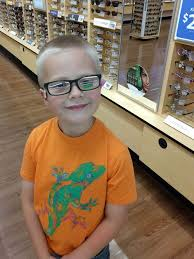 happy boy with his favorite color on his glasses