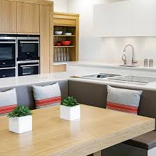 kitchen island with bench seating. A Booth Sits Snugly Inside An L-shaped Island Unit In This Scheme. Kitchen With Bench Seating R