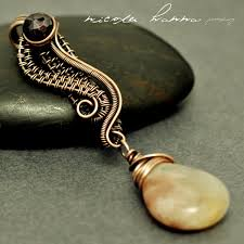 Curly Q Pendant by Nicole Hanna.