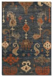 ikat rug hand knotted cut jute dyed gray burnt orange taupe home decor