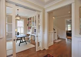 plantation shutters for sliding glass doors home office traditional with area rug beige built in bookshelves crown molding1