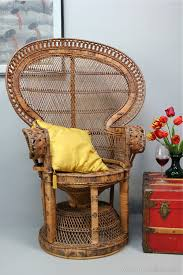 1960 s retro chic is embod in the pea chair beautifully and intricately woven in rattan and wicker with a caned seat and large fan back