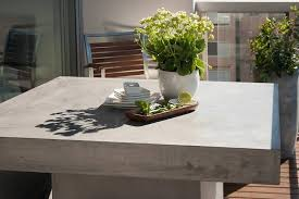 outdoor table and chairs sydney. grc grey square fibreglass outdoor table featured on a balcony and chairs sydney