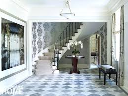 cool gray tones greet guests entering this art style home from the floors reclaimed ceramics tiles