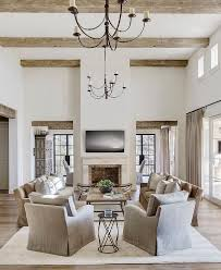chandelier for high ceiling family room gorgeous rustic ceiling beams hold iron chandeliers over a
