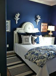cool bedroom paint colors scheme with solid blue wall paint and some wall decor in white adorable blue paint colors