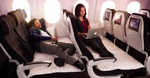 business woman sitting on the air new zealand economy skycouch