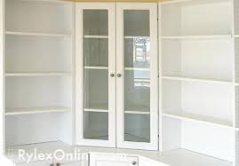 close on white cabinets with doors and shelving