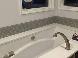 add height to backsplash in bathroom