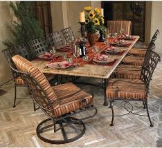 great round wrought iron kitchen table for dining space with marble top and striped motif on attractive rod iron patio