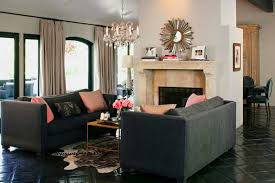 living room furniture in gray color and decorative pillows in pink color