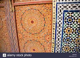 ornate carved wooden doors to a mosque with mosaic tile work in the medina fez northern morocco e47 work