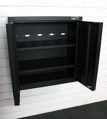 wall mounted black metal garage cabinet with door for small garage spaces with wooden wall painted with white color ideas