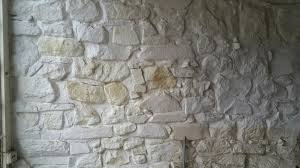 painted stone wallRenovating an old stone cottage Sandblasting painted walls