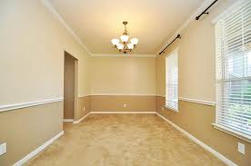 view of formal dining room from the doorway nice chair rail with two tone paint scheme