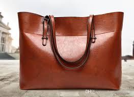 2018 hot ing large women s shoulder bags real leather smooth zipper handbag black brown genuine leather handbags hobos bag 2 size