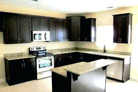 kitchen dark cabinets granite brown with light coloured worktops counter island table chairs stone white countertops