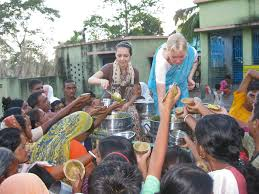 Image result for images of man distributing prasadam