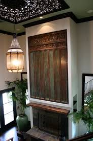 antique carved indonesian door panel and roof tile in wood  on indonesian wooden wall art with antique carved indonesian door panel above fireplace d cor