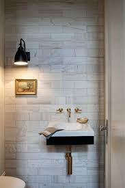 powder room sinks wall mount faucet powder room transitional with white stone tile chrome bathroom sink