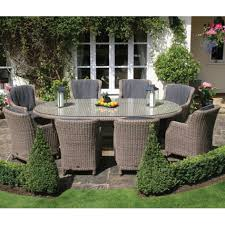 round rattan patio table design with 8 person patio furniture sets and 2 chandles on