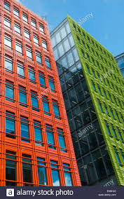 a bright orange and green facade on an office building at central saint giles in london england uk brightly colored offices central st