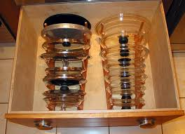 Pot lid storage in drawer using bamboo organisers. I wonder what the  dimensions are?