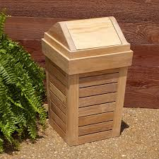 outdoor teak waste basketadd an earthy touch to your outdoor area with the teak waste basket the lid has a magnetic closing feature which keeps waste