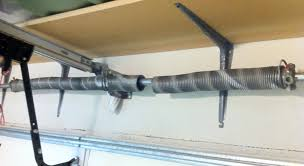 jackshaft picture of a broken spring needing to be repaired garage doors
