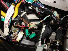 disconnected wiring harnesses under the steering wheel subaru 2015 subaru forester trailer wiring harness at Replacing Rear Wiring Port And Wiring Harness In Suburu Forester