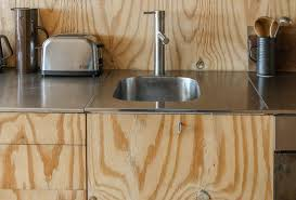 the thin stainless steel countertops and integrated stainless prep sink were originally from ikea the