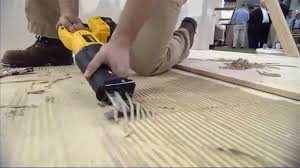 removing tile glue from wooden floor