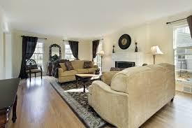 dark brown hardwood floors living room. The Blonde Colored Hardwood Flooring In This Traditional Living Room Balances Out Sheer Dark Curtains Brown Floors