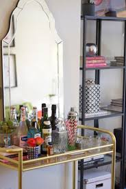 A beveled mirror makes a spray-painted DIY cart look instantly elegant.  Even the big ones come cheap! (Photo Credit: Devon Rachel)