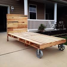with Cart Wheels - 42 DIY Recycled Pallet Bed Frame Designs