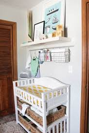 modern changing station with cubbies and racks above it for storage