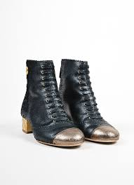 chanel quilted boots. black and gold chanel leather lace up quilted heel ankle boots frontview