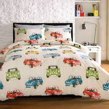 take a mini adventure with this quirky printed bed linen featuring the classic mini model with a sporty twist red blue green and yellow cars on a cream