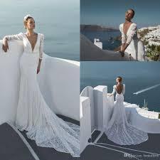 Designer Sheath Wedding Dresses 2019 Designer New Beach Long Sleeves Lace Sheath Wedding Dresses Plunging V Neck Beaded Sequined Sexy Backless Bridal Gowns Grecian Style Wedding