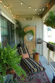 Balcony decor ideas...love the lights