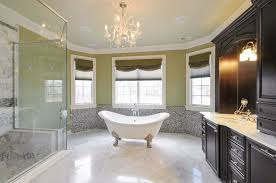 luxury bathroom with white double slipper clawfoot bathtub with nickel feet and crystal chandelier
