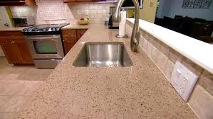 the new quartz countertop and sunken sink complete the kitchen renovations