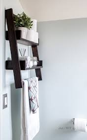 combine diy floating shelves and diy ladder shelves to create this unique open shelf the step by step plans
