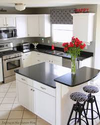 white kitchen cabinets with black countertops. Brilliant With Makeover The Kitchen By Painting And Adding An Island For White Kitchen Cabinets With Black Countertops N