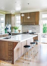 new kitchen furniture. the expansive new kitchen has double caesarstonetopped islands rift and quartersawn oak cabinets are a modern interpretation of shaker style furniture